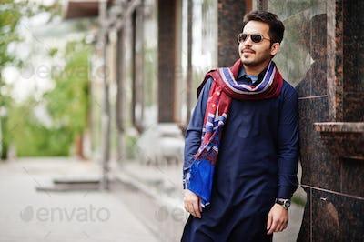Stylish pakistani indian muslim arabic man in kurta dhoti suit and sunglasses.