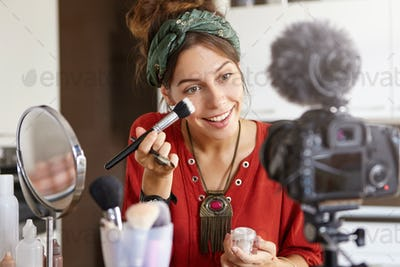 People, commercial and modern technologies concept. Pretty young woman advertises new facial cream,