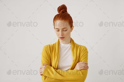 Human facial expressions and body language. Indoor isolated portrait of elegant attractive young fem