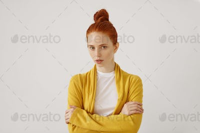 Beauty, people, youth and lifestyle concept. Studio shot of charming young redhead woman with freckl