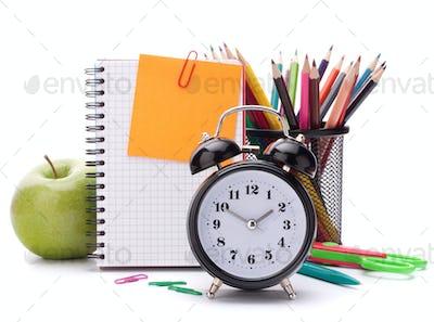 Alarm clock, blank notebook sheet and apple.