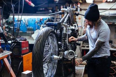 Repairman in garage