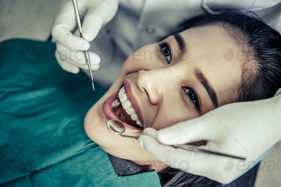 Dentists treat patients' teeth.