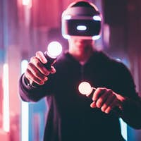 Faceless man using VR headset in dark interior with neon light lamps