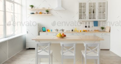 Utensils, bright cups and kettle, shelves with dishes and plants in pots, refrigerator