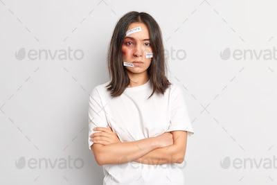 Women cruelty pressure concept. Brunette Asina woman beaten by violent husband becomes victim of abu
