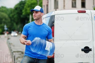 Delivery men in front cargo van delivering bottles of water.
