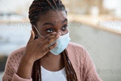 Closeup Shot Of African American Woman Wearing Medical Mask Rubbing Her Eye