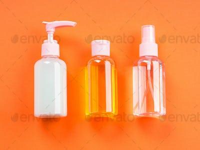Generic beauty products on orange background.