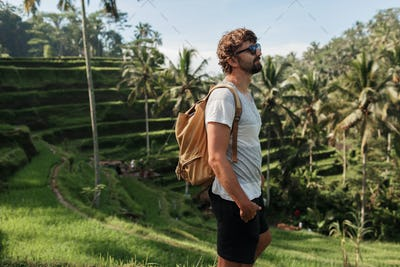 Outdoor portrait of Handsome travel man  with back pack