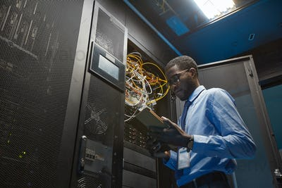 African American Network Engineer in Server Room