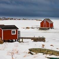 Shacks at frozen shore of Joe Batts Arm NL Canada