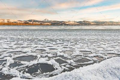 Ice floes at shore of Lake Laberge Yukon Canada