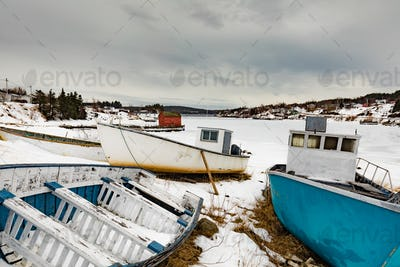 Small fishing boats beached for winter NL Canada