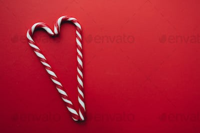 Christmas candies on red background, red white lollipop