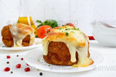 Potato balls with minced meat in deep fat, baked with mozzarella.