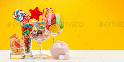 Various sweets assortment in cocktail glasses