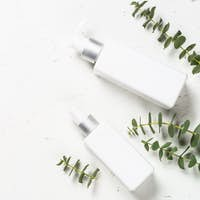 Eucalyptus cosmetic, spa product at white table.