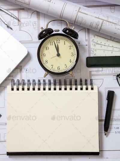 Architect engineer blank notebook, laptop and alarm clock