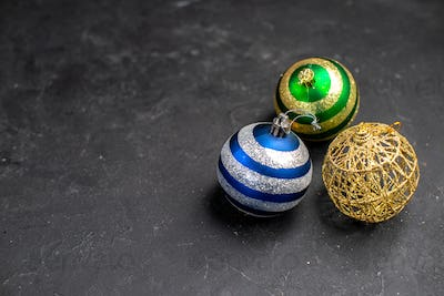 top view xmas tree balls on dark isolated background with free space