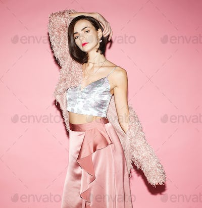fashion woman in pink clothing isolated on pink background