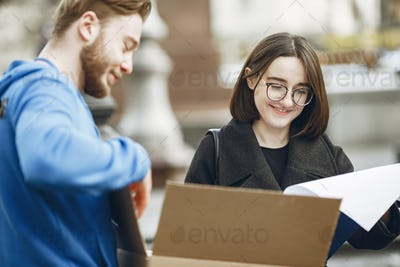 Man gives a parcel to a female client