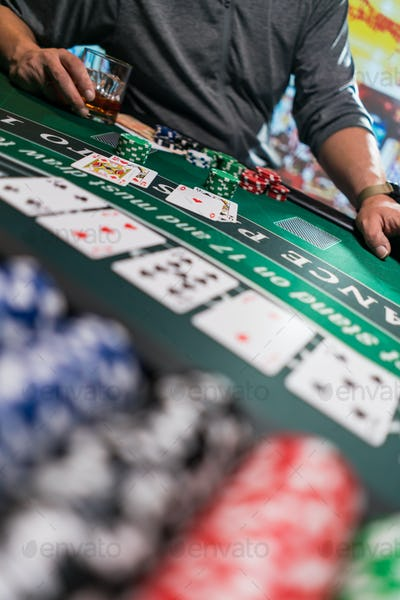 Man playing BlackJack at the casino