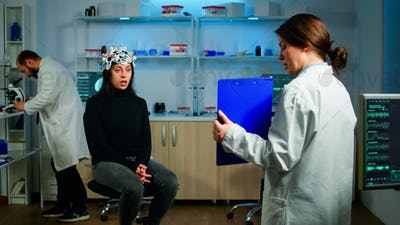 Professional doctor in neurological medicine testing eyesight of patient