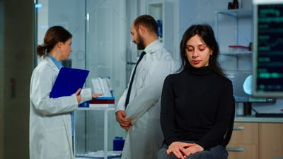 Team of scientists doctor discussing health status of patient