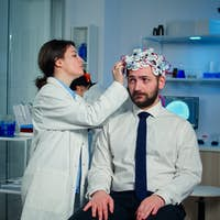 Man patient visiting professional medical researcher