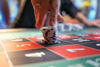 Woman playing roulette at the casino