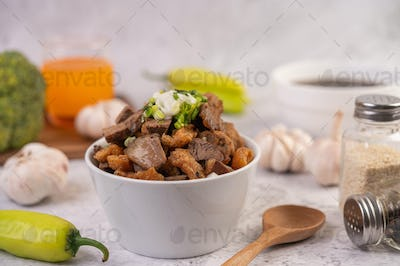 Kuay Jab  in a cup with pork Meatball and Pork Cracker.