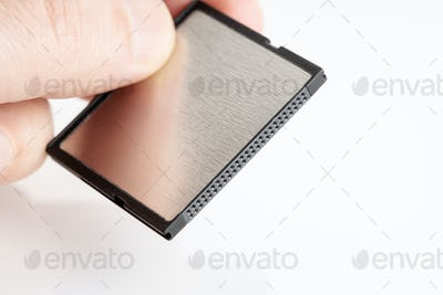 Hand holding a Compactflash memory card