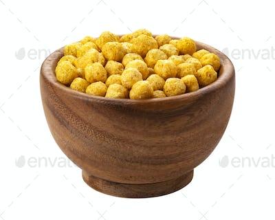 Sweet corn balls flakes isolated on white background