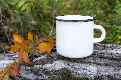 White campfire mug mockup with fall leaf