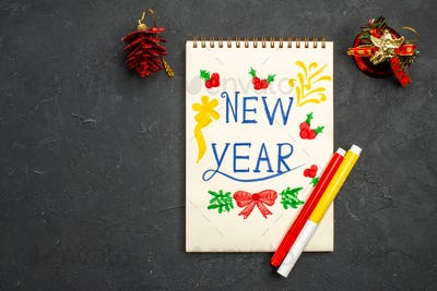 top view new year writing drawn on notepad on dark background new year photo xmas color free place
