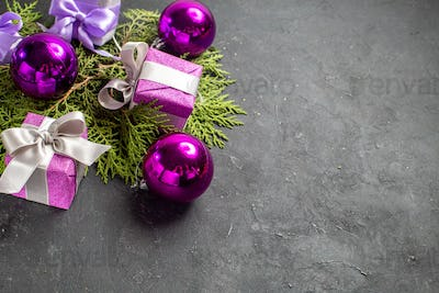 Half shot of colorful gifts and decoration accessories on dark background