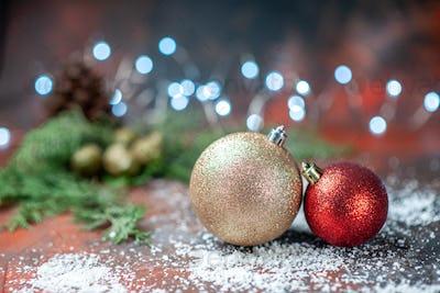 front view xmas tree balls coconut powder on dark isolated background xmas lights