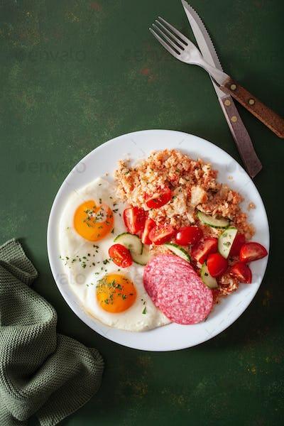 ketogenic paleo diet breakfast. cauliflower rice, fried egg salami