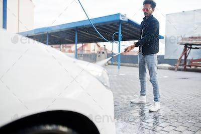Asian man and car