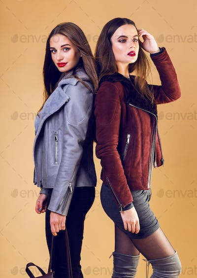 Two sexy models in casual trendy spring outfit