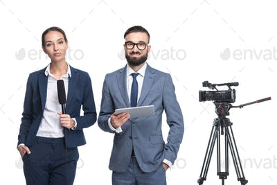 announcers with digital tablet standing near tv video camera, isolated on white