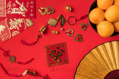 top view of fan with characters, greeting cards with calligraphy, oriental decorations and