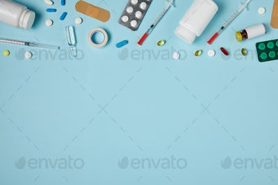 top view of various medicines on blue surface