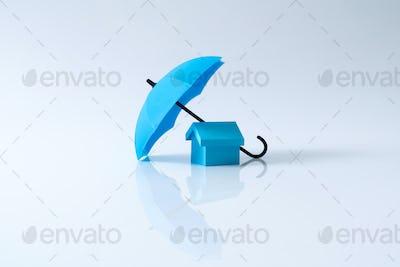 House model under blue color umbrella
