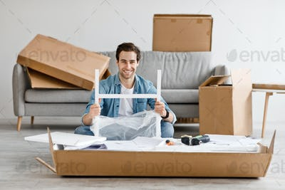 Positive emotions of person, moving to new house and assembling furniture with own hands