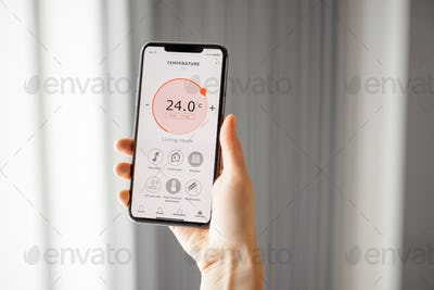 Smartphone with launched application for temperature adjustment