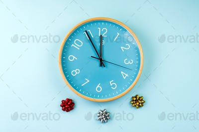 Closeup of colorful wall clock on blue background