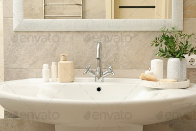 Sink and personal hygiene accessories in bathroom