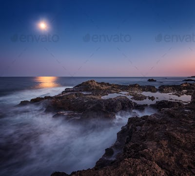 Rocky coastline on moonlight